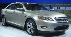 Price reductions on models such as the Ford Taurus helped Ford to major Q3 sales.